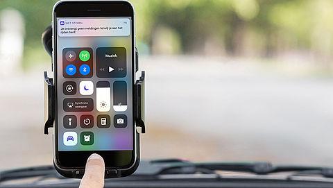 Automatisch bericht versturen met je iPhone tijdens autorit}
