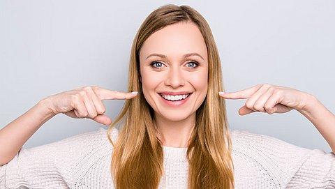 Wat kan ik naast tandenpoetsen doen om gaatjes te voorkomen?