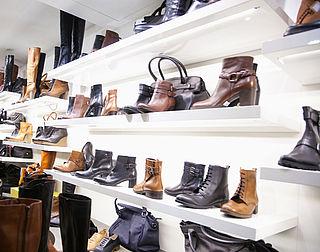 Doek valt voor schoenenketens Macintosh
