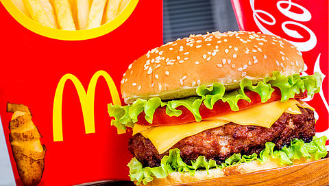 Cheeseburger weg uit Happy Meal van McDonald's }