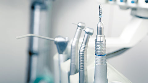 Tandartsen tegen borende mondhygiënist