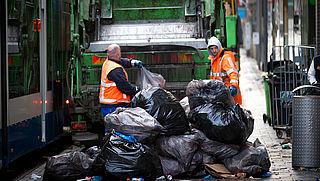 Inwoners steden produceren minste afval